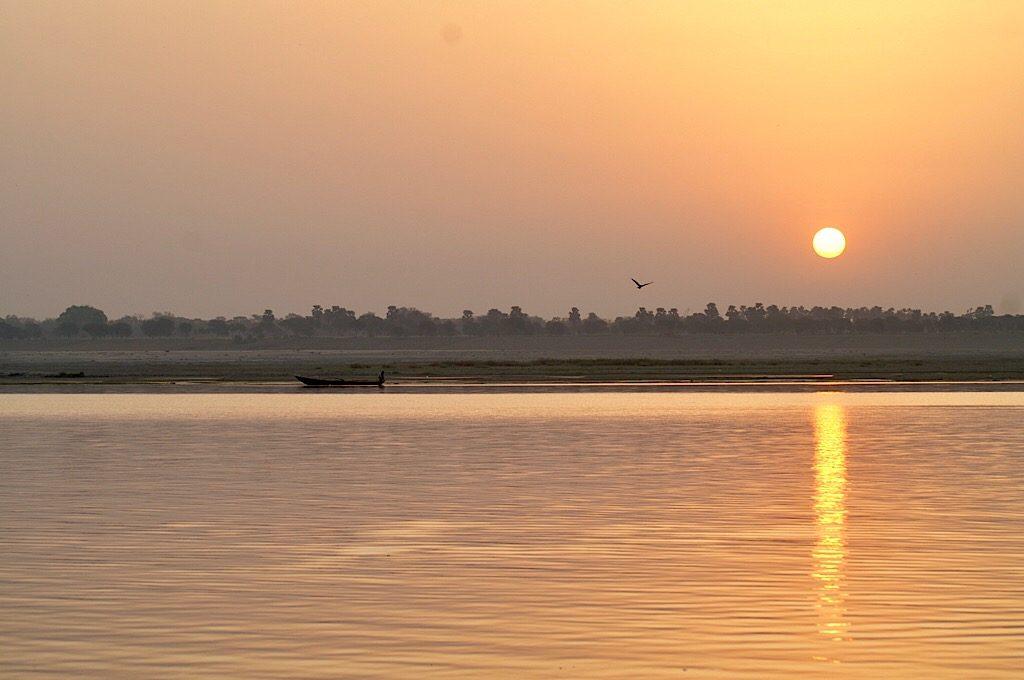 Zonsondergang aan de Ganges