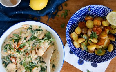 Garnalen in knoflookroomsaus met spinazie en Parmezaanse kaas