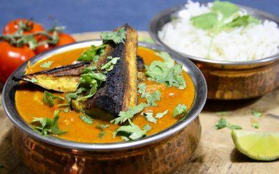 Geroosterde aubergine curry met tomaat en kokos